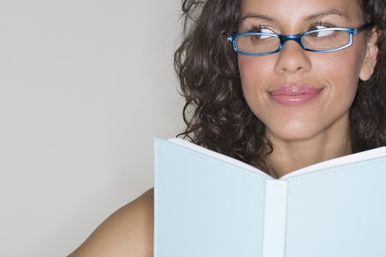 Young Woman Looking Away from Book
